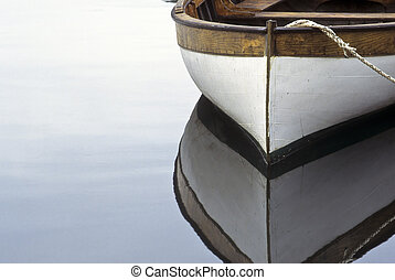 Rowboat and reflection in water - Rowboat, rope and...