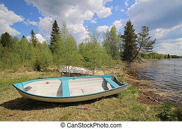 Rowboat at the edge of a Swedish lake