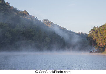 Rowboat on the lake at morning fog at Mae Hong Son or Pang Ung