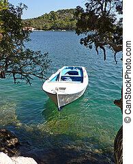 Romantic rowboat in the ocean