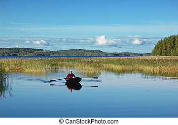 Rower on a Finnish lake