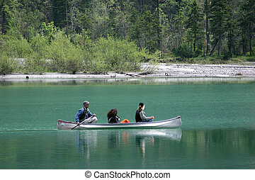 Rowers on Lake - Rowers in small canoe in cold austrian lake