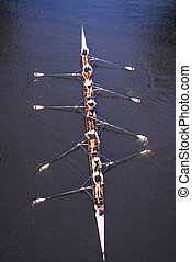 Rowing - A rowing team pratice rowing in the evening on a ...