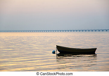 Rowing boat at sunset