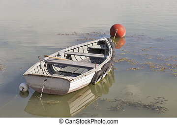 Rowing boat moored on lake Balaton, Hungary. - Old rowing...