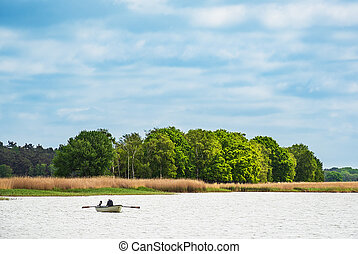 Rowing boat on a lake in Born, Germany