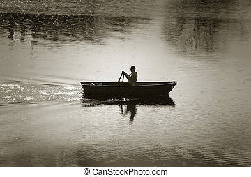 rowing-boat - a man in his rowing-boat, Stockholm
