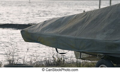 Rowing boat under cover during the winter months in very windy weather