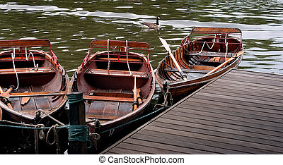 Rowing Boats - Three rowing boats moored on a lake