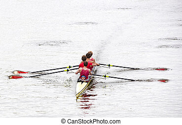 Rowing - Coxed four rowing towards the camera, on a bleak ...