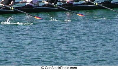 Rowing - Rowers in eight-oar rowing boats, slow motion full...