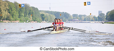 Rowing Regatta - Four oarsmen in a coxed boat during a...
