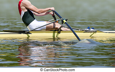 Rowing stroke - Close up of a muscular skiff rower during...
