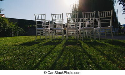 Rows of chairs for the wedding ceremony - Chairs stand on...