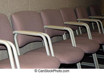 Rows of chairs in a meeting hall