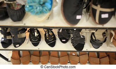 Rows of elegant, colored women's shoes on store shelves. HD. 1920x1080