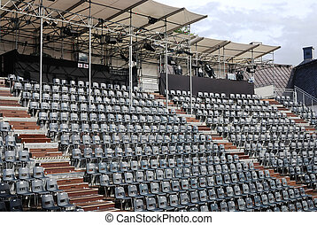 rows of empty black plastic seats
