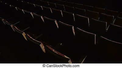 Rows Of Empty Red Chairs In The Theater