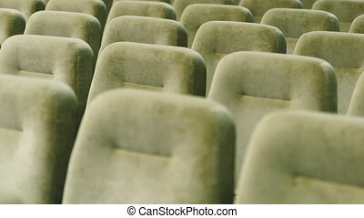 Rows of empty seats in a movie theater