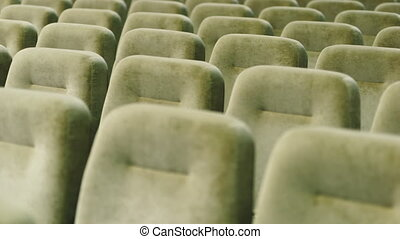 Rows of empty seats in a theater