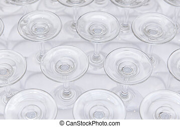 rows of Empty wine glass bottoms on white table