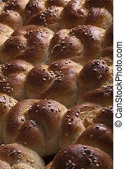 rows of fresh sesame seed buns