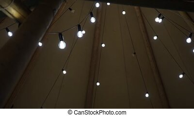 rows of light bulbs under the dome of a tent
