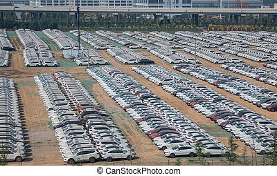 Rows of new cars ready for delivery in Zheng Zhou Dong