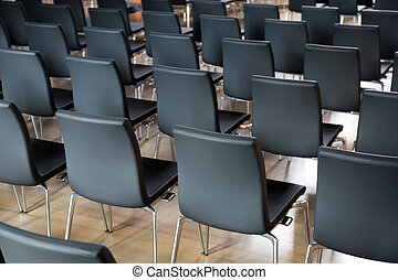 Rows of new chairs in the conference hall