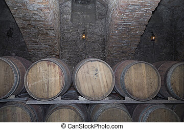 Rows of oak tuns in the old wine cellar. Wine cellar of the...