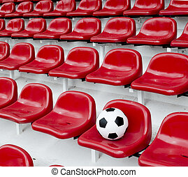 Rows of red football stadium seats with numbers