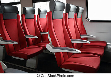 rows of red seats in train