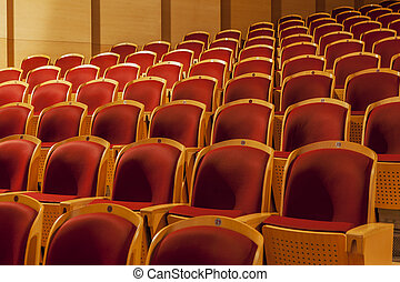 rows of red theater seats