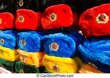 0230d901da09b Rows of russian winter hats of different colors with army emblems at the  street market at
