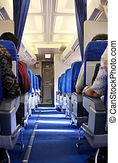 rows of seats in airplane aisle