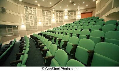 rows of seats in empty conference hall