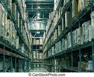 Rows of shelves with boxes in modern large-scale warehouse