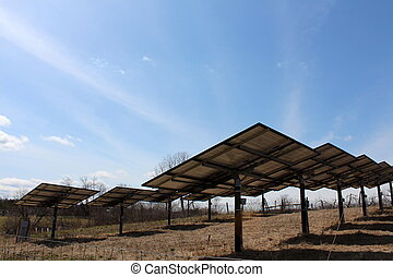 Rows of solar panels in field