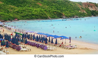 rows of sunbeds on the beach thailand