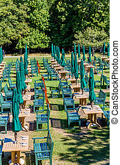 Rows of Tables with Green Benches