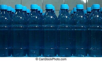 Rows of water bottles.