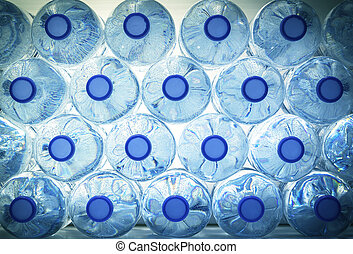 Rows of water in plastic bottles