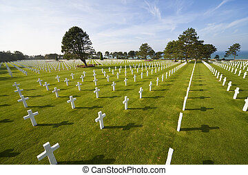 Rows of white crosses at the World War 2 American Cemetery,...