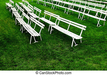 Rows of White Park Benches for Sitting on Green Grass - Rows...