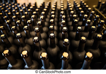 Rows of wine bottles in cellar