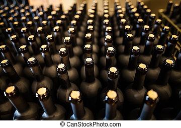 Rows of wine bottles in cellar