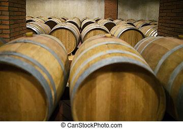 Rows of wooden wine barrels - Rows of wooden barrels in wine...