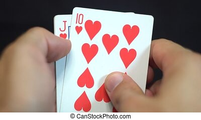 Royal Flush Hearts. Gambler player revealing royal straight...