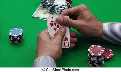 royal flush of hearts in hand gambler