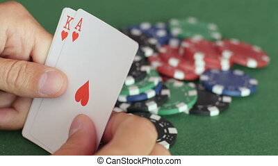 Royal flush of hearts on hands